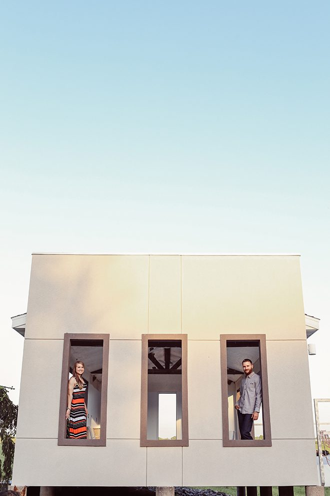 Man and Woman standing in windows | Modern Country Engagement | Brandy Swartz Photography