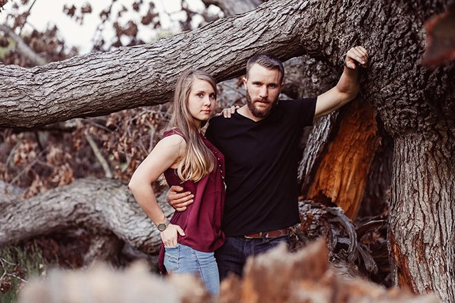 Couple standing beside tree | Modern Country Engagement | Brandy Swartz Photography