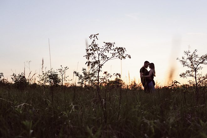 Engaged couple at sunset | Modern Country Engagement | Brandy Swartz Photography