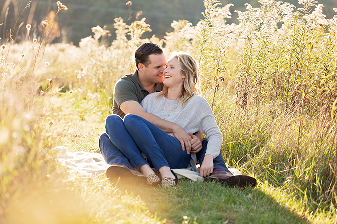 Couple sitting in field | Michigan Fall Engagement | The MittenTog