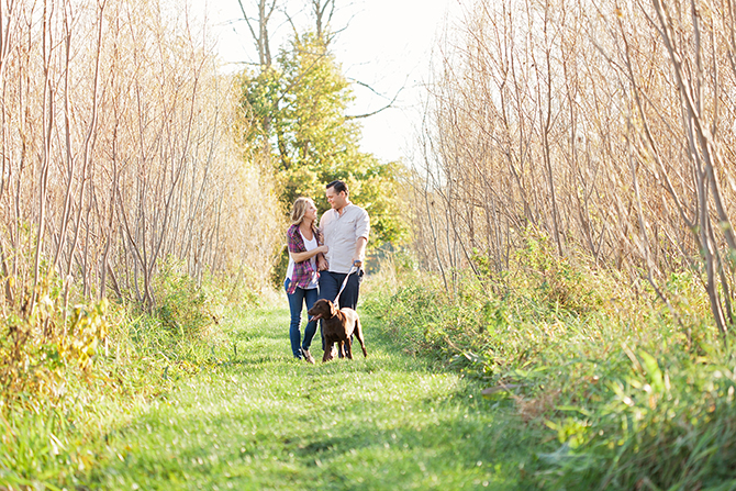 Couple walking dog | Michigan Fall Engagement | The MittenTog