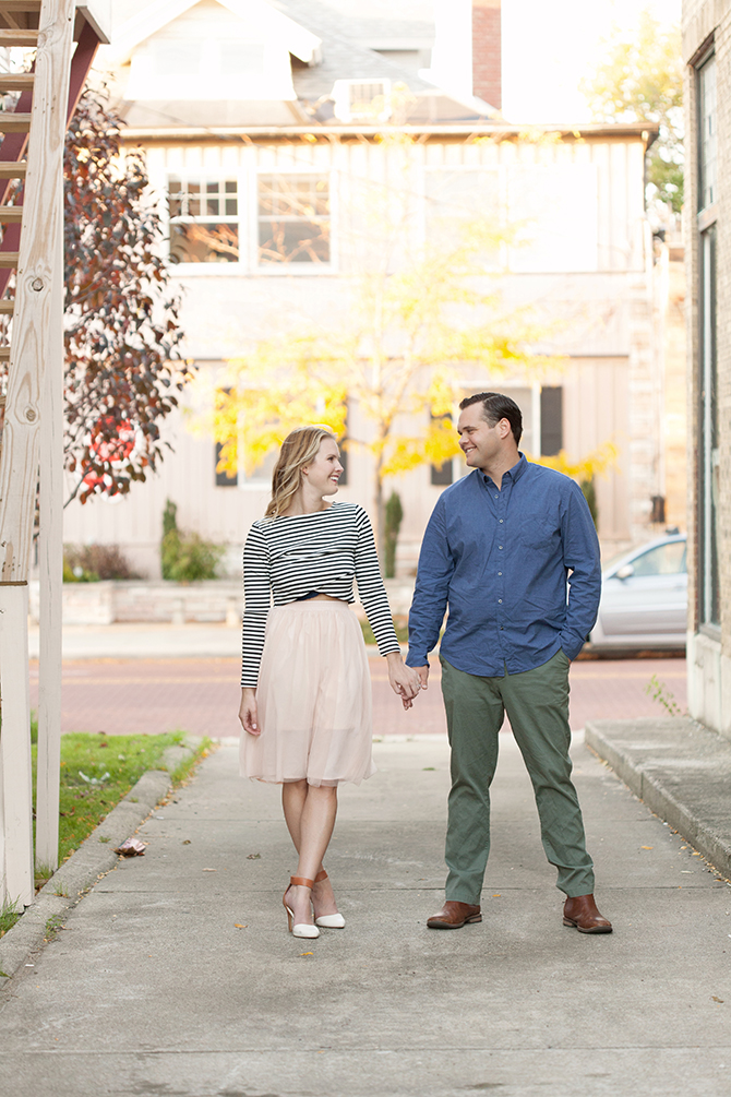 Engaged couple standing in side street | Michigan Fall Engagement | The MittenTog