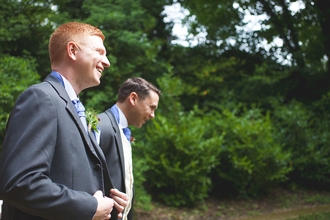 Groom and best man laughing before ceremony | Outdoor Humanist Wedding | Ragdoll Photography