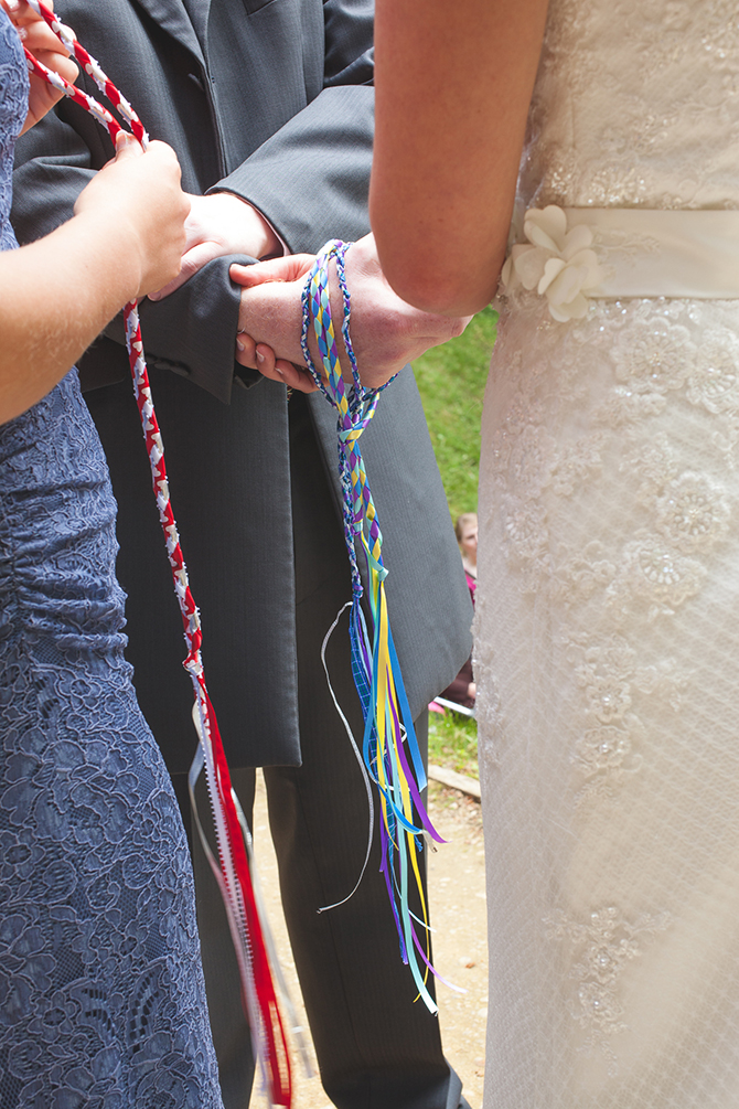 Tying the ropes around bride and groom | Outdoor Humanist Wedding | Ragdoll Photography