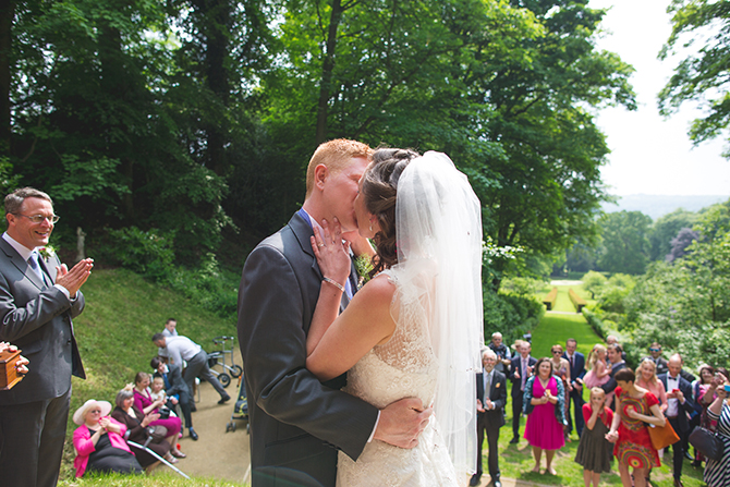 Bride and Groom kissing at outdoor ceremony | Outdoor Humanist Wedding | Ragdoll Photography
