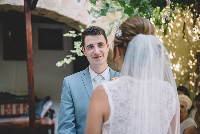 Couple standing at wedding ceremony | Rustic Wedding in Cyprus | Christodoulou Photography