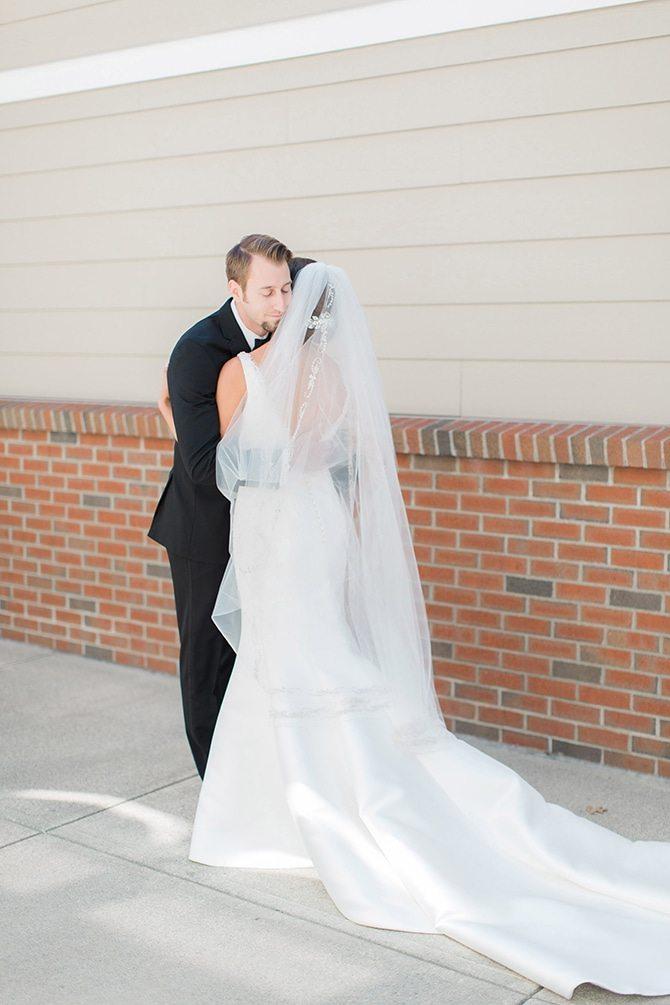 Wedding couple hug | Lake Side Wedding | Krystal Balzer Photography