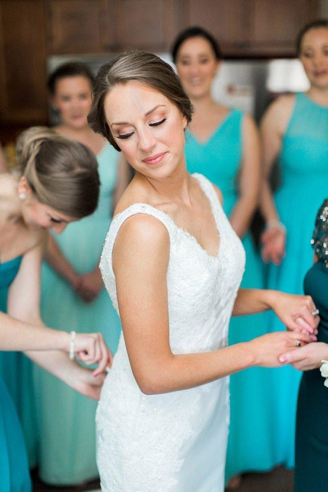 Bride putting on her dress | Lake Side Wedding | Krystal Balzer Photography