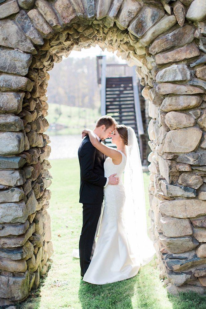 Newlyweds in arch | Lake Side Wedding | Krystal Balzer Photography