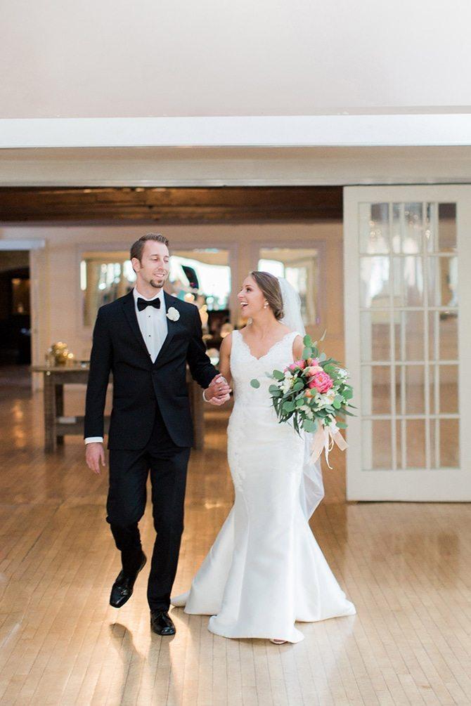 Newlyweds arriving to wedding reception | Lake Side Wedding | Krystal Balzer Photography
