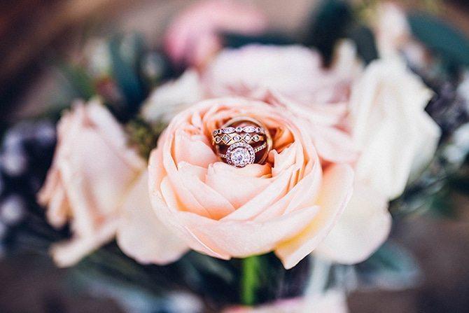 Wedding rings in flowers | Charming Barn Wedding | Kate Olson Photo