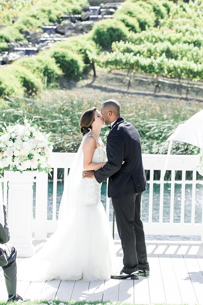 Couple kissing at ceremony | Vineyard Wedding in Hollister | Amy Bluestar Photography