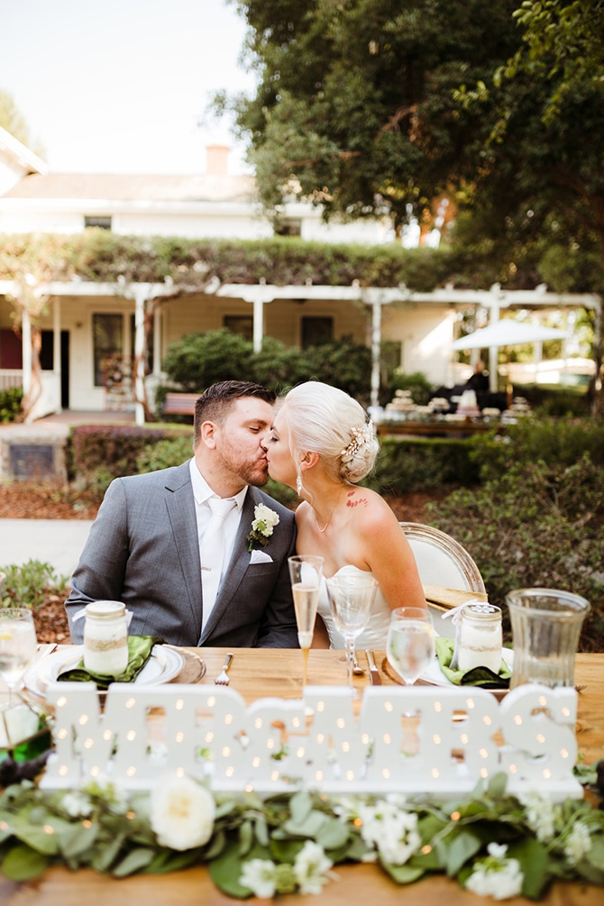 Wedding couple at top table | Rustic Wedding in Mountain View | Emily Jean Images