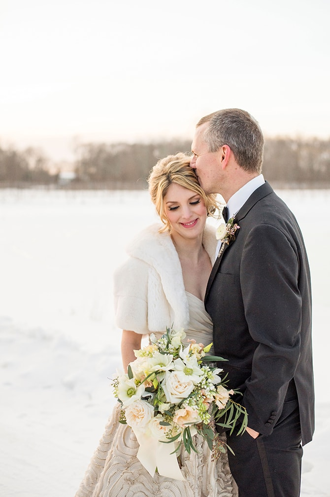 Couple kissing in snow | Glamorous Snowy Vineyard Wedding | Tonya Damron Photography