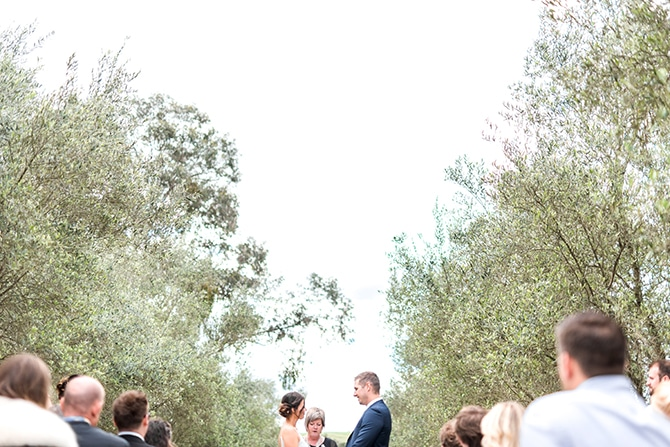 Bride and Groom at wedding ceremony | Olive Tree Vineyard Wedding Raquelle Loraine Photography