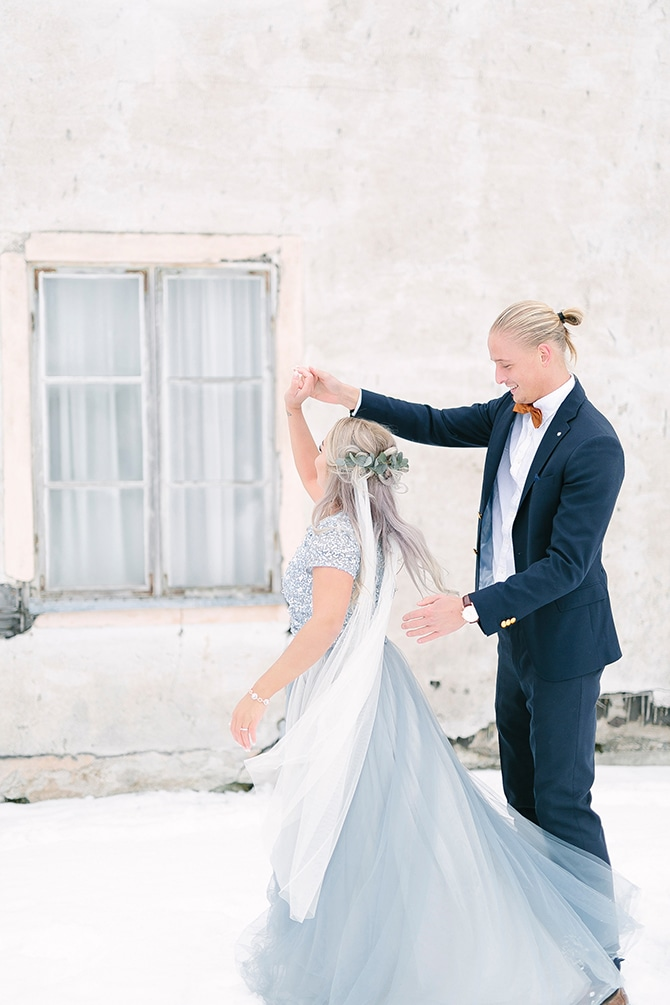 Bride and Groom dancing in snow | Swedish Winter Wedding Style Linda-Pauline Photo