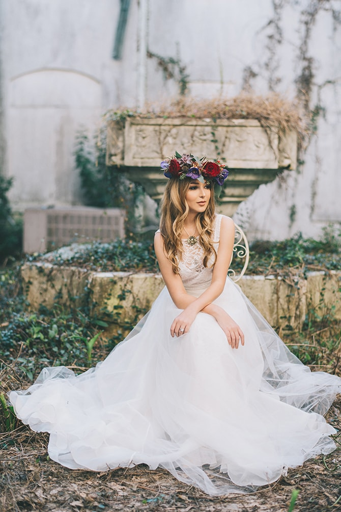Bride sitting in garden courtyard | Secret Garden Wedding | Sarah Mattix Photography