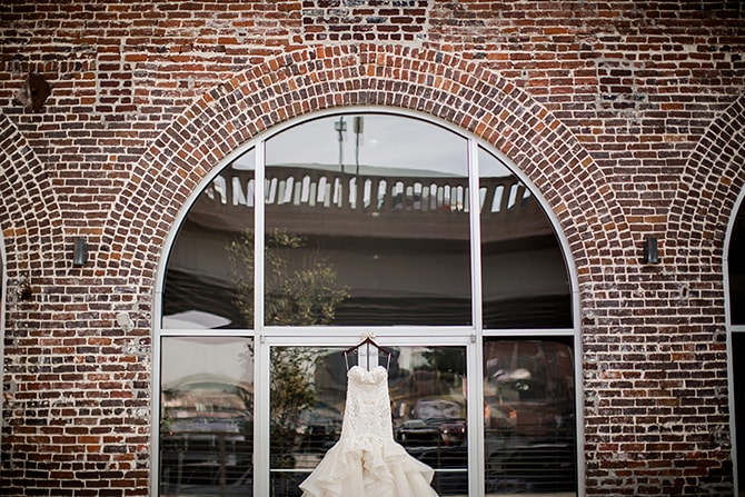 Bridal gown hanging | Urban Wedding at Jackson Terminal Train Station | Amanda May Photos