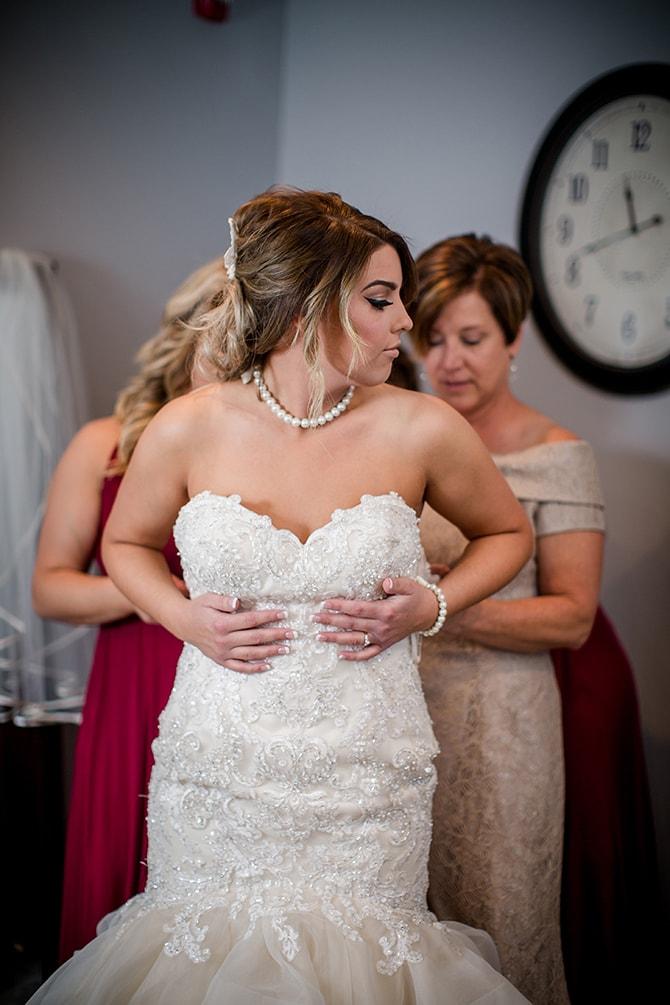 Bride getting into gown | Urban Wedding at Jackson Terminal Train Station | Amanda May Photos