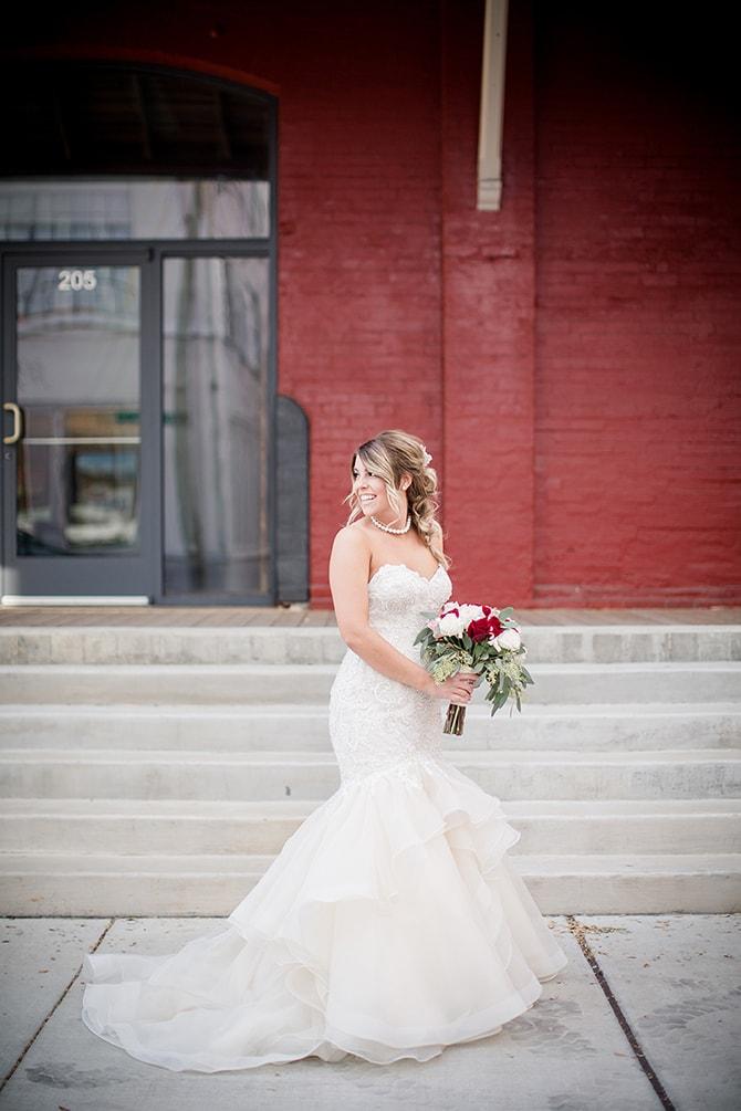 Bride outside beside red brick wall | Urban Wedding at Jackson Terminal Train Station | Amanda May Photos
