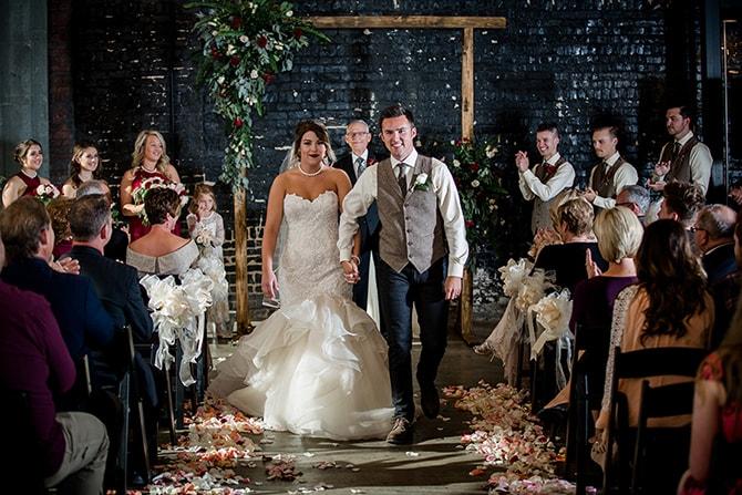Couple walking down aisle | Urban Wedding at Jackson Terminal Train Station | Amanda May Photos