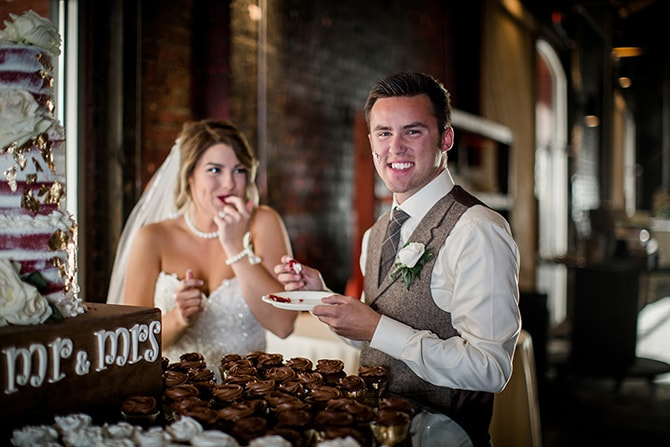 Newlyweds eating wedding cake | Urban Wedding at Jackson Terminal Train Station | Amanda May Photos