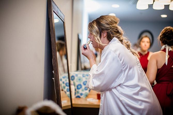 Bride applying lipstick | Urban Wedding at Jackson Terminal Train Station | Amanda May Photos