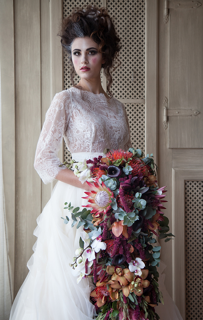 Artistic bride holding flowers | Artist Themed Wedding | Rosie Photography