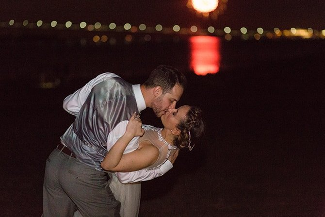 Kiss at sunset | Coastal Fort Wedding in Rhode Island | Ellysia Francovitch Photography