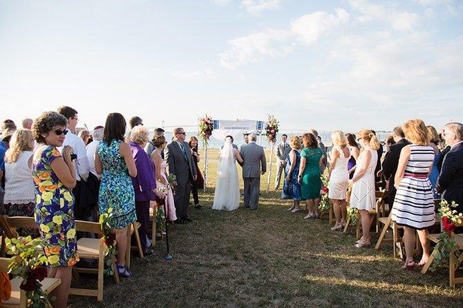 Bride walking down aisle | Coastal Fort Wedding in Rhode Island | Ellysia Francovitch Photography