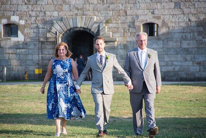 Groom walking to ceremony | Coastal Fort Wedding in Rhode Island | Ellysia Francovitch Photography