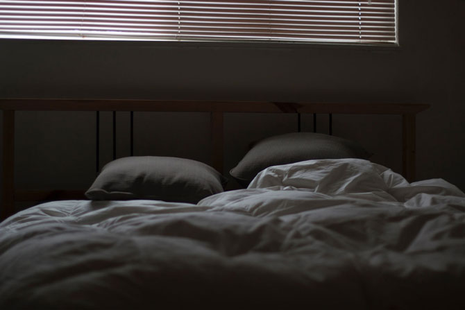Bed in darkness