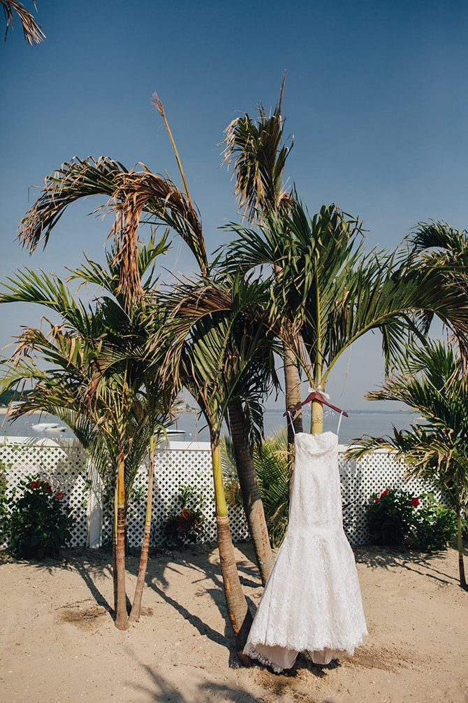 Wedding dress hanging in palm trees | Contemporary Beach Wedding in New York | Martina Micko Photo