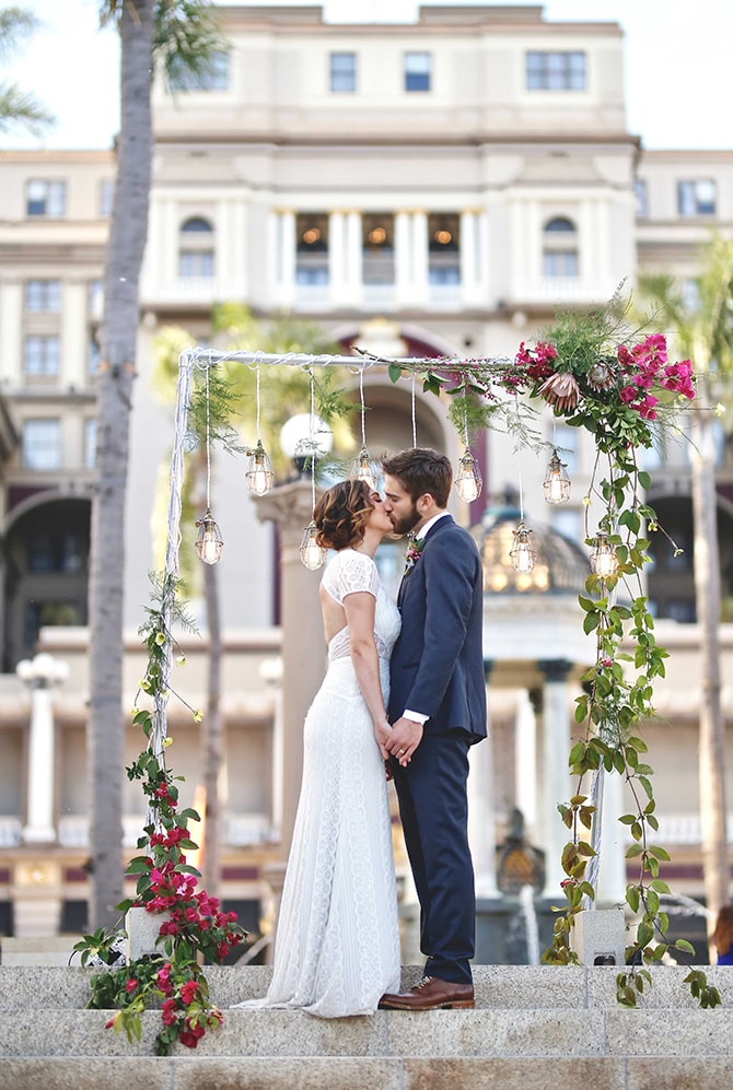 Bride and Groom kissing at ceremony | Urban Chic City Wedding at Horton Plaza | Willmus Weddings