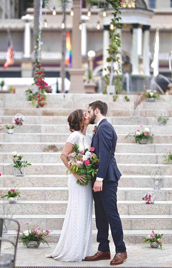 Kissing at the ceremony | Urban Chic City Wedding at Horton Plaza | Willmus Weddings