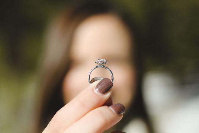 Woman Holding Wedding Ring