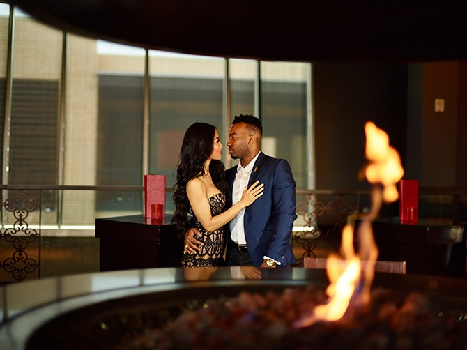 Couple sitting beside fire | City Honeymoon Fashion Inspiration | CivicPhotos