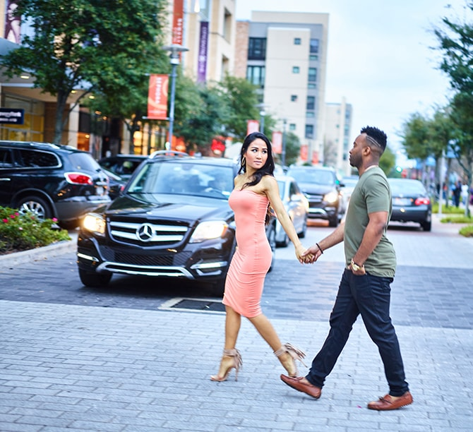 Stylish couple crossing the road | City Honeymoon Fashion Inspiration | CivicPhotos
