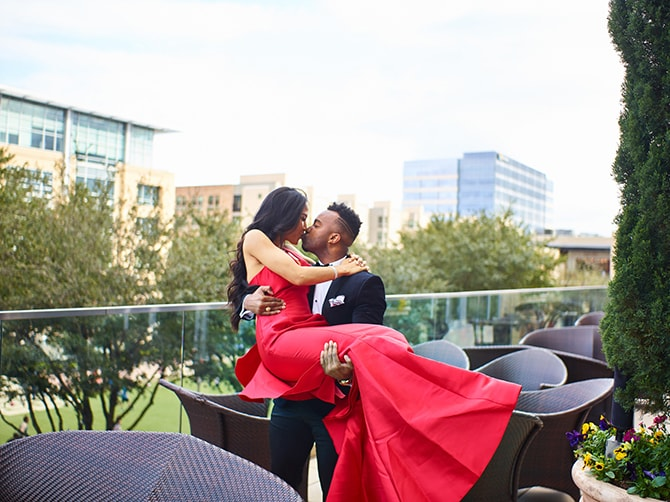 Couple kissing on balcony | City Honeymoon Fashion Inspiration | CivicPhotos