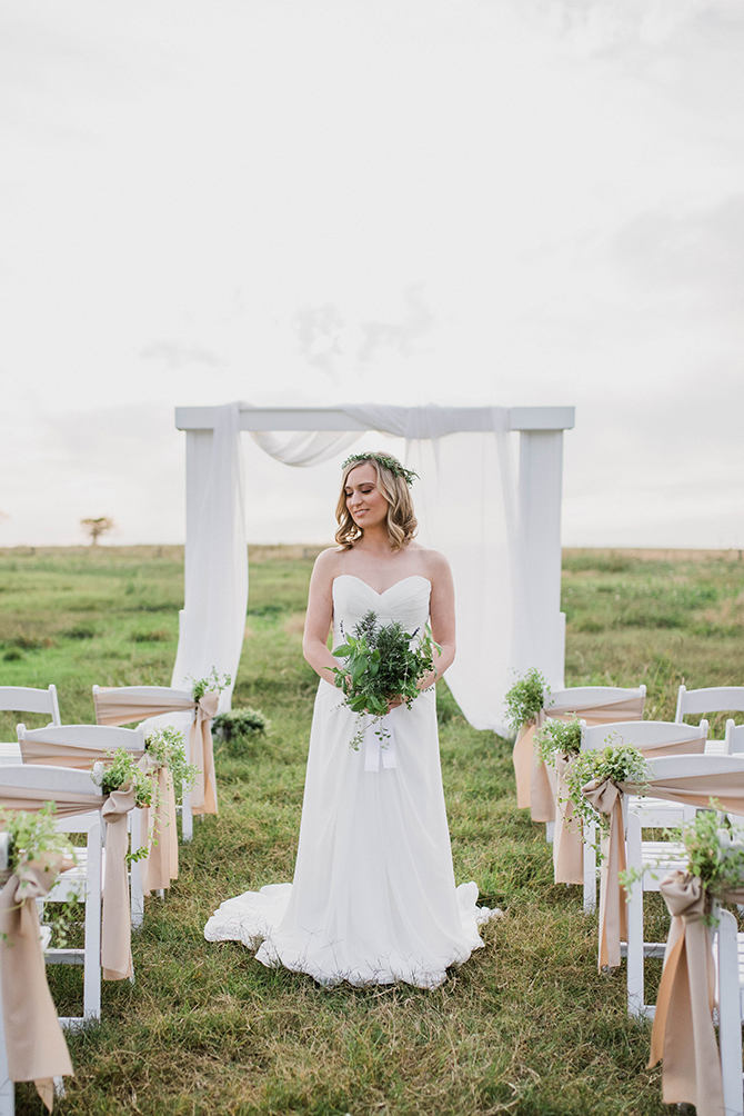 Bride at ceremony in field | Countryside Sunset Wedding in Texas | Rebecca Chesney Photo