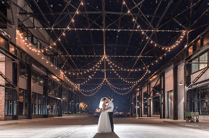 Newlyweds underneath lights | Minmalistic Industrial Retreat in Southern Wisconsin | Erik Anderson