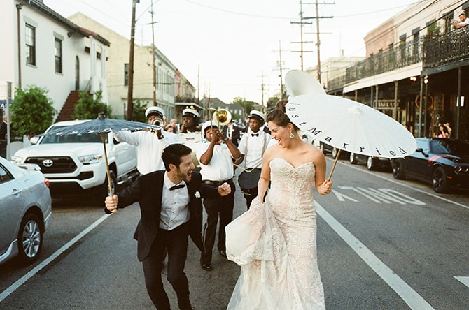 Newlyweds walking with wedding band | Sophisticated New Orleans Nuptials | Arte De Vie