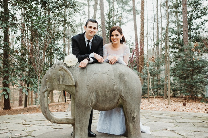 Bride and Groom with Elephant statue | Glamorous Spring Wedding Portraits at The Swan House | Aline Marin Photography