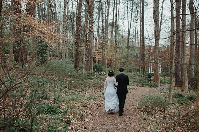Couple walking through woodlands | Glamorous Spring Wedding Portraits at The Swan House | Aline Marin Photography