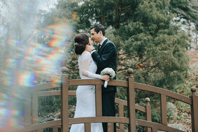 Couple on bridge | Glamorous Spring Wedding Portraits at The Swan House | Aline Marin Photography