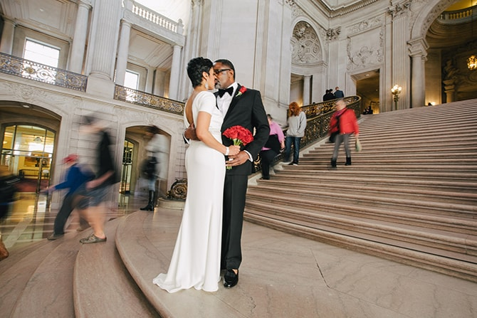 Kissing outside San Francisco City Hall | Intimate Ceremony at San Francisco City Hall | IQphoto Studio