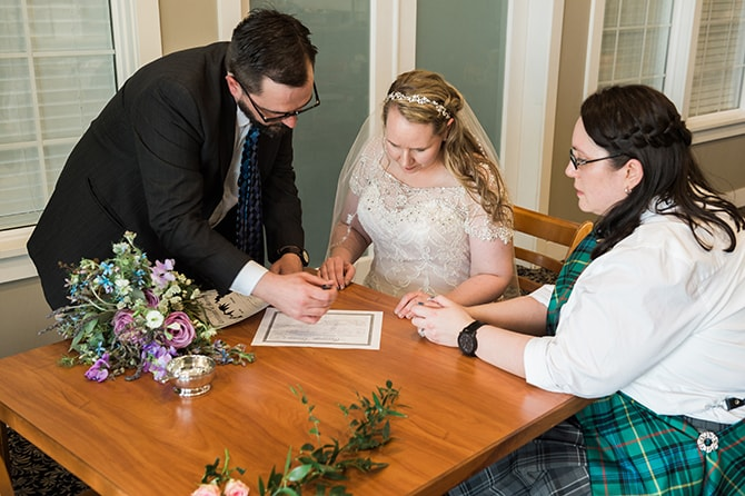 Brides signing the registrar | Scottish Inspired Wedding in Utah | Derek Chad Photography