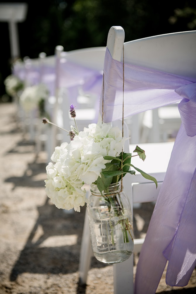 Hanging flowers on ceremony chairs | Stylish and Modern Farm Wedding | Amanda May Photos