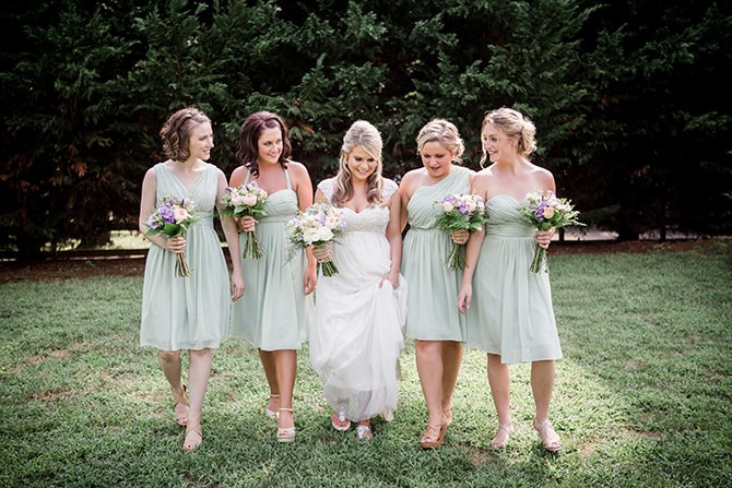 Bride walking to wedding with bridesmaids | Stylish and Modern Farm Wedding | Amanda May Photos