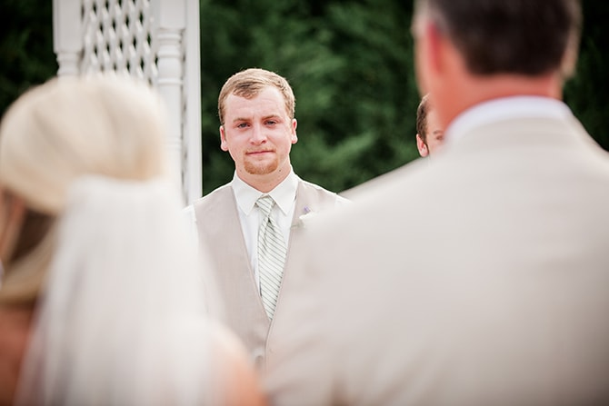 Groom watching bride | Stylish and Modern Farm Wedding | Amanda May Photos